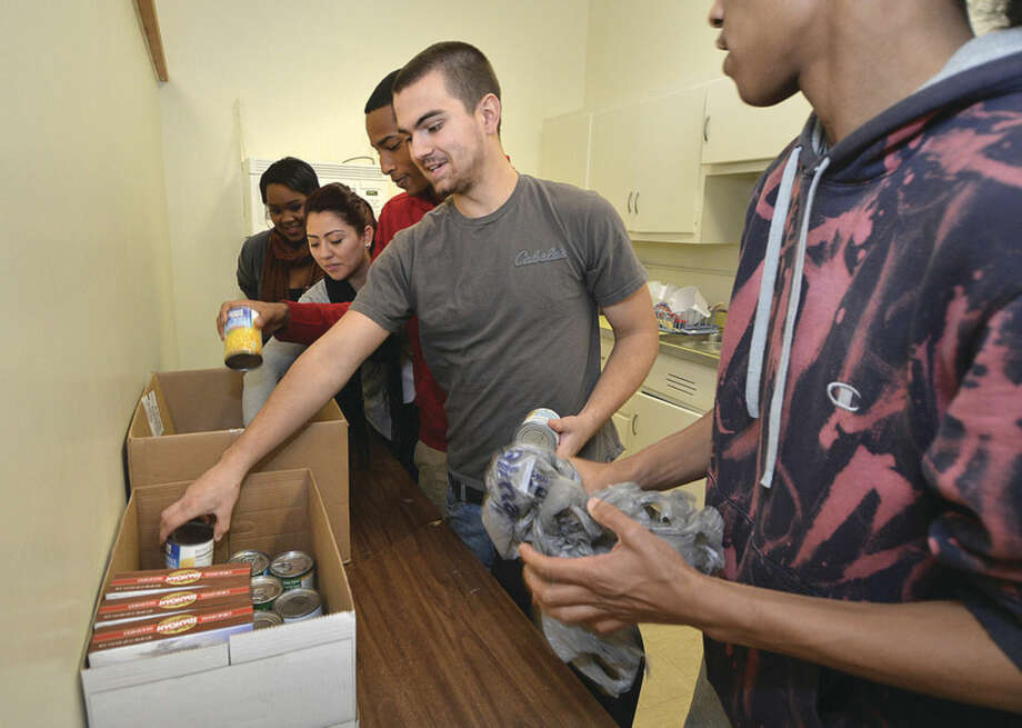 Hour photo/Alex von KleydorffBrea Joubert, Marcella Menjivar, Jaquan Burden, John Roddy and Alfred Jacobs sort food for the Briggs High School food drive.