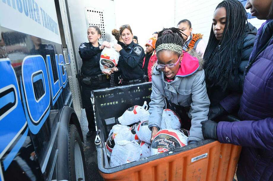 The Stamford Police Association donates 55 turkeys to the Food Bank of Lower Fairfield County and delivers them with the help of the members of the SPA's Girls Leadership Program.