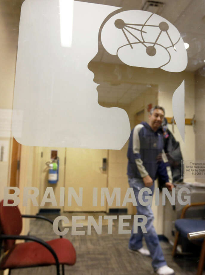 "Scott Kurdilla, a medical research technologist at Carnegie Mellon University, waits for a volunteer for a brain scan experiment on campus in Pittsburgh on Wednesday Nov. 26, 2014. The brain-scanning MRI machine at the center was used in a recent experiment where each word of a chapter of ""Harry Potter and the Sorcerer's Stone"" was flashed for half a second onto a screen inside a brain-scanning MRI machine. Images showing combinations of data and graphics were collected. (AP Photo/Keith Srakocic)"
