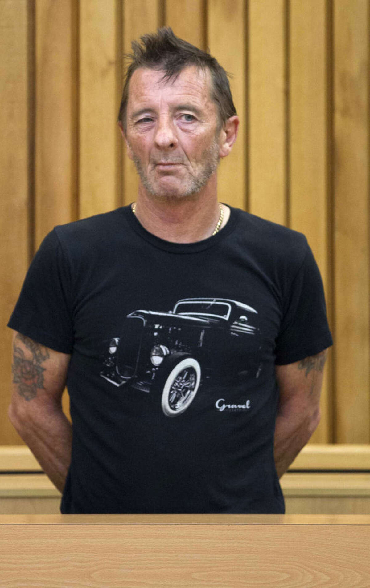 Phil Rudd, drummer for the rock band AC/DC, stands in the dock in the High Court at Tauranga, New Zealand, Wednesday, Nov. 26, 2014. The 60-year-old is charged with threatening to kill, which comes with a maximum prison sentence of seven years, as well as possessing methamphetamine and marijuana. (AP Photo/New Zealand Herald, Alan Gibson) NEW ZEALAND OUT, AUSTRALIA OUT