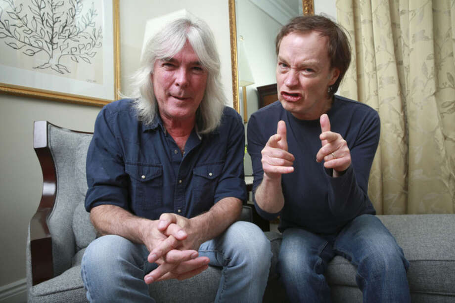 "FILE - In this Nov. 13, 2014 file photo, members of the rock band AC/DC, bassist Cliff Williams, left, and guitarist Angus Young pose for a portrait in promotion of their upcoming album, ""Rock or Bust"" in New York. The new album releases on Tuesday, Dec. 2, 2014. (Photo by Amy Sussman/Invision/AP, File)"