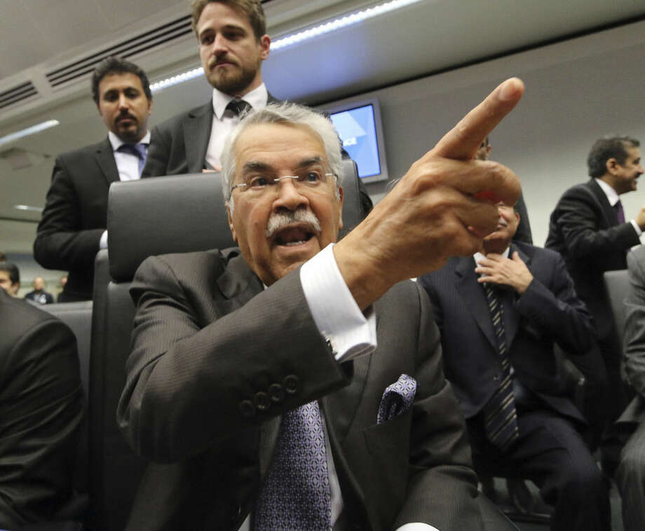 Saudi Arabia's Minister of Petroleum and Mineral Resources Ali Ibrahim Naimi speaks to journalists prior to the start of a meeting of the Organization of the Petroleum Exporting Countries, OPEC, at their headquarters in Vienna, Austria, Thursday Nov. 27, 2014. Expectations that the group would not cut output to support the market saw the global price of oil slump another US dollar 1.89 on Thursday to US dollar 75.86 a barrel, extending its losses since June, when it was as high as US dollar 115. (AP Photo/Ronald Zak)