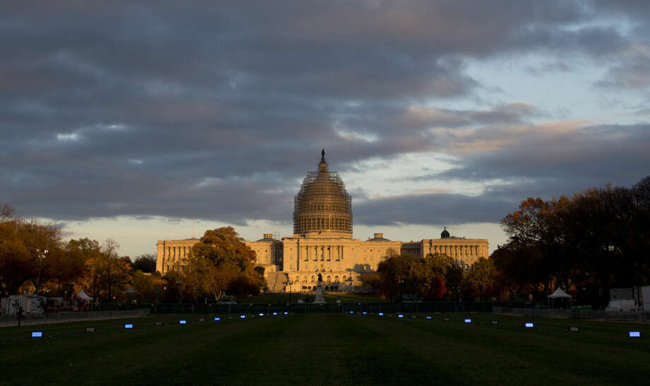 FILE - This Nov. 11, 2014 file photo shows the U.S. Capitol Building illuminated by the setting sun on the National Mall in Washington. Local organizers believe a major project such as the Olympics would be able to bring groups in the city together, even Republicans and Democrats. (AP Photo/Carolyn Kaster, File)