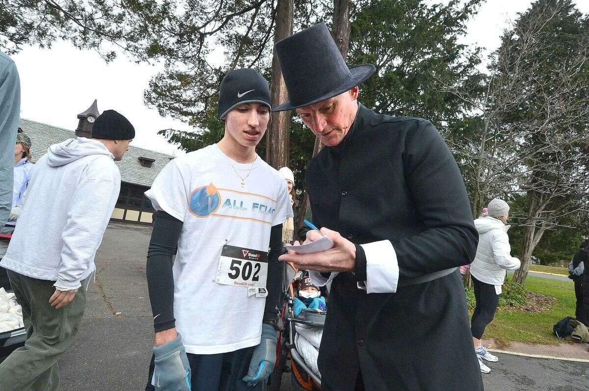 Hour Photo/Alex von Kleydorff Winner eric Vanderek gives his information to one of the organizers Cameron Letters