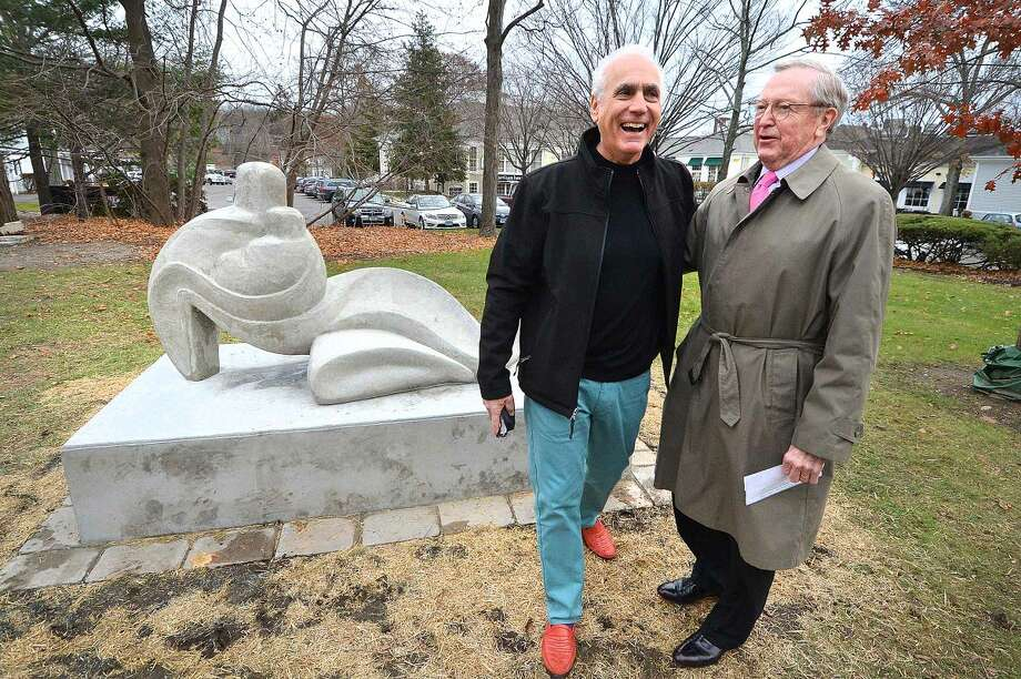 "Wilton First Selectman Bill Brennan helps Peter Rubino unveil his sculpture ""Nurture"" in Wilton Center."