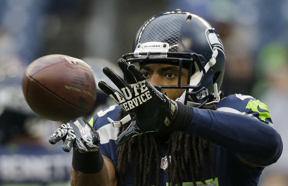 FILE - In this Nov. 9, 2014, file photo, Seattle Seahawks cornerback Richard Sherman warms ups before an NFL football game against the New York Giants in Seattle. For the first time since flexible scheduling came to