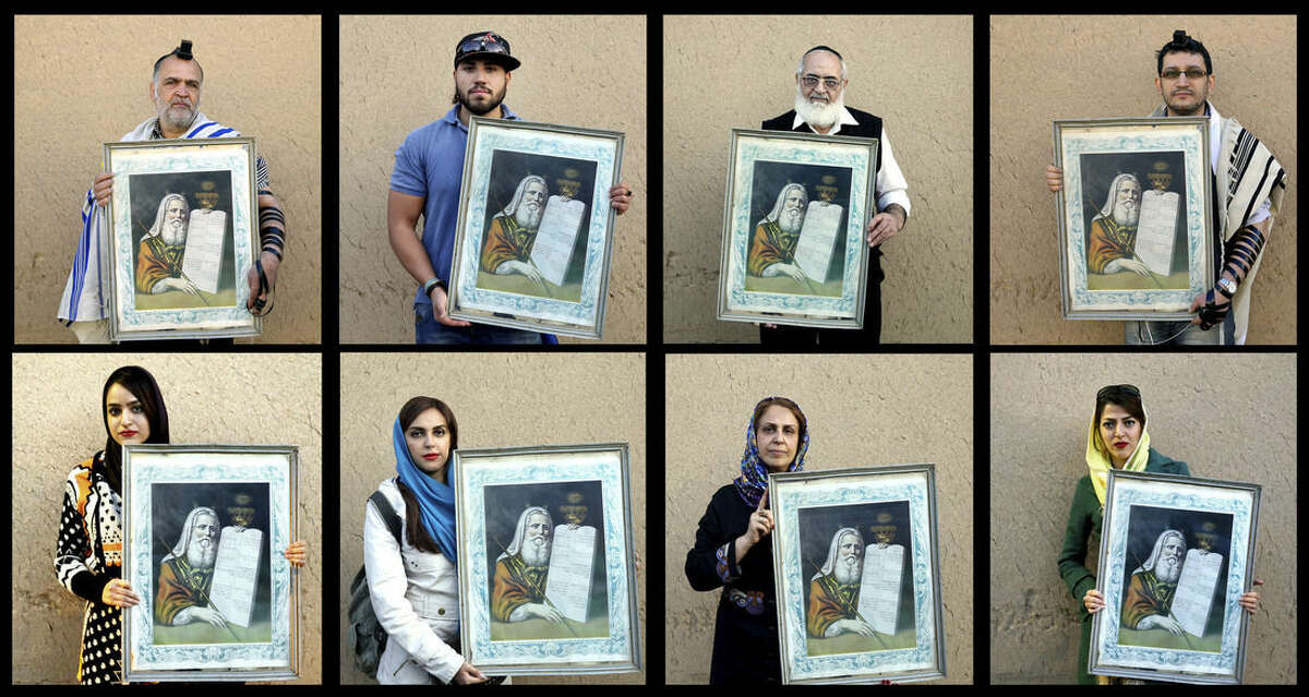 In this Nov, 2014 combo image made up of 8 photos, Iranian Jews pose for photographs holding a painting of Moses with