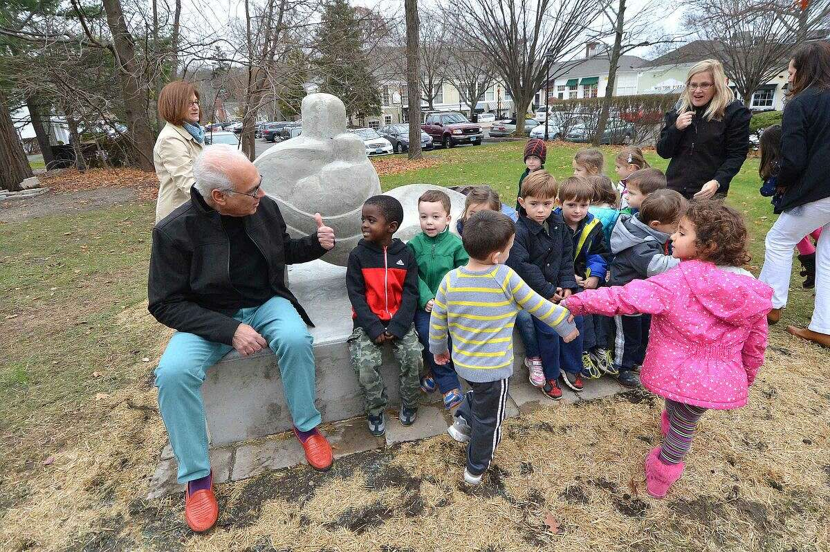 Peter Rubino invites children from Community Nurdery School to check out his new sculpture