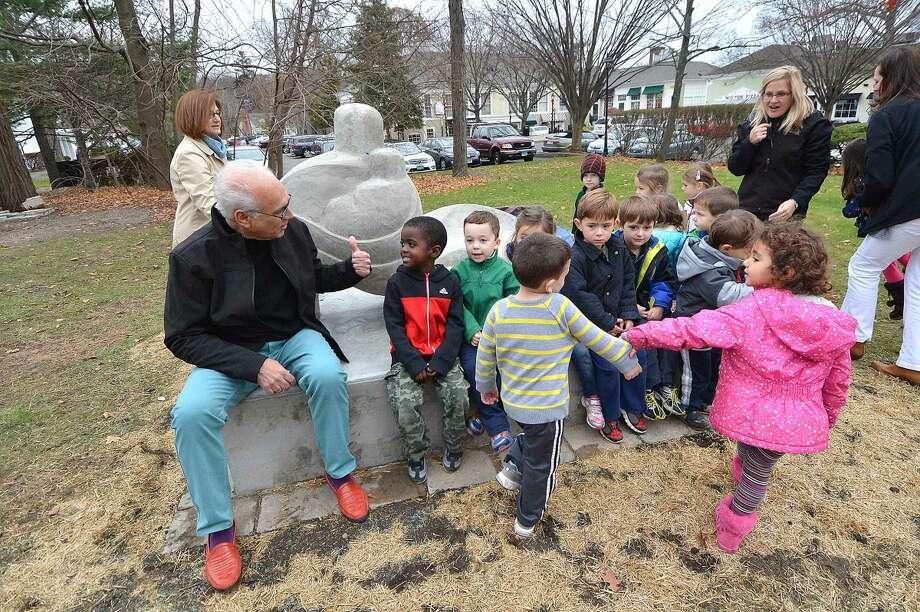 "Peter Rubino invites children from Community Nurdery School to check out his new sculpture ""Nurture"" in Wilton Center."