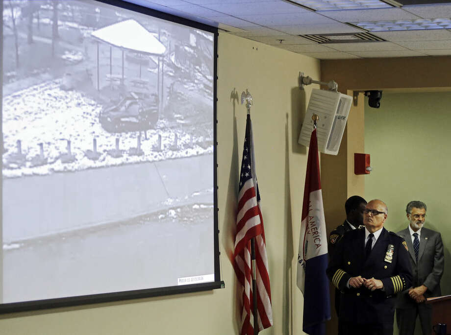 Cleveland Police Deputy Chief Ed Tomba, second from right, shows surveillance video of the weekend police shooting of Tamir Rice during a news conference Wednesday, Nov. 26, 2014, in Cleveland. The 12-year-old was fatally shot by a Cleveland police officer Saturday after he reportedly pulled a fake gun at the city park. (AP Photo/Mark Duncan)