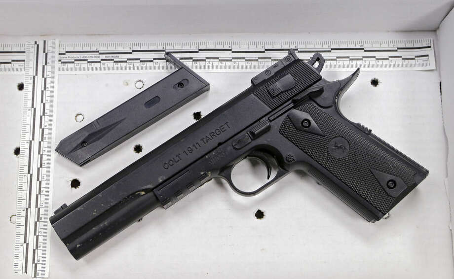 This fake handgun taken from 12-year-old Tamir Rice, who was fatally shot by Cleveland police over the weekend, is displayed after a news conference Wednesday, Nov. 26, 2014. The 12-year-old was shot at a city park after he reportedly pulled the Colt 1911 replica on arriving officers. (AP Photo/Mark Duncan)