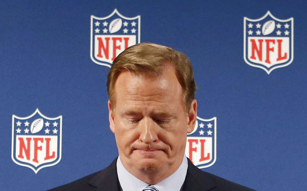 FILE - In this Sept. 19, 2014, file photo, NFL Commissioner Roger Goodell pauses as he speaks during a news conference in New York. Rice has won the appeal of his indefinite suspension by the NFL, which has been