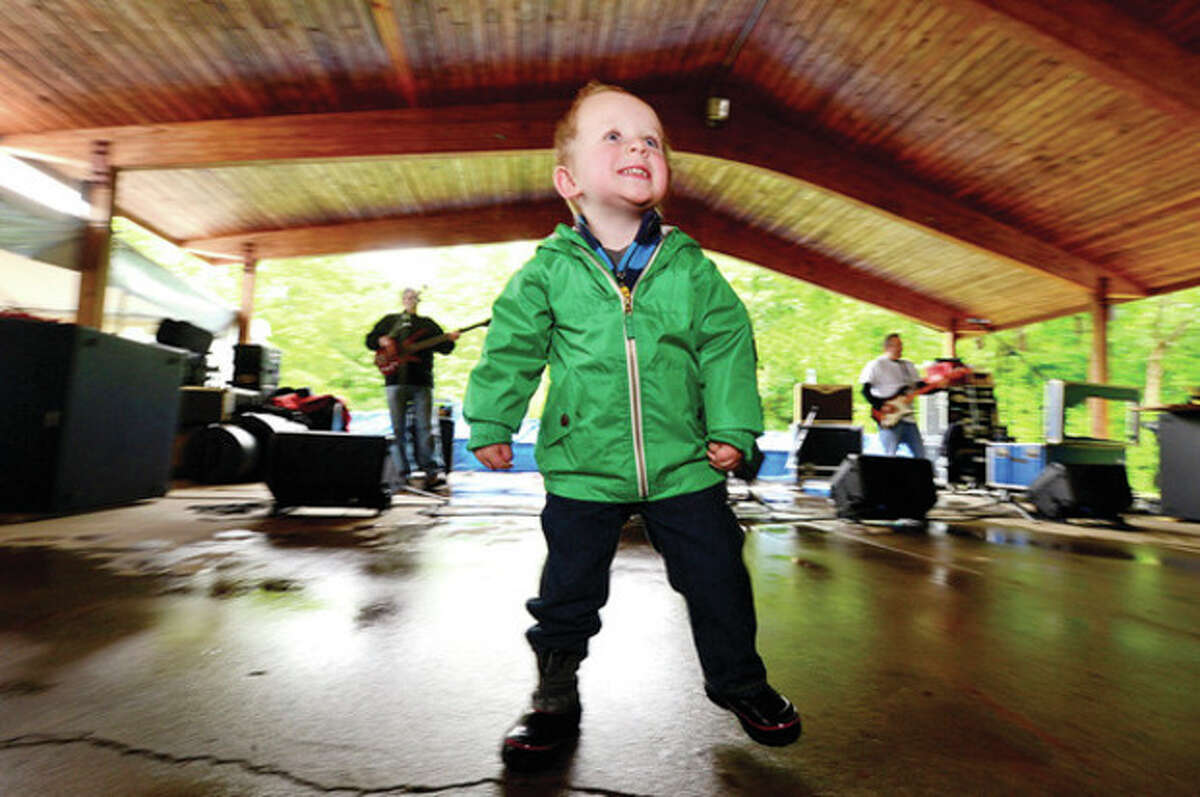 Ronan Scully, 2, dances to the sound of PJ Pacifico at Music for Angels benefit concert saturday at Cranbury Park. The concert will benefit the Tiny Miracles Foundation. Hour photo / Erik Trautmann