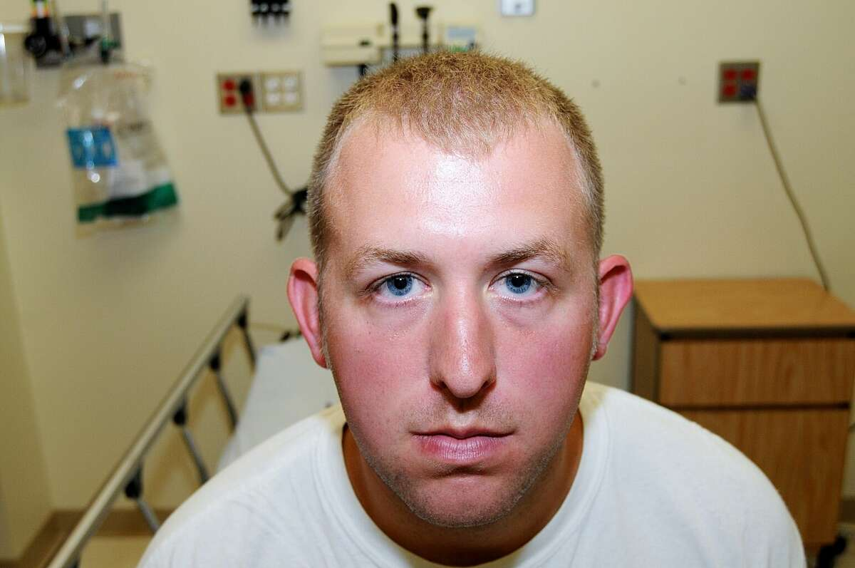 FILE- This undated file photo released by the St. Louis County Prosecuting Attorney's office on Monday, Nov. 24, 2014, shows Ferguson police officer Darren Wilson during his medical examination after he fatally shot Michael Brown,in Ferguson, Mo.The white police officer who killed Michael Brown has resigned from the Ferguson Police Department, nearly four months after the confrontation that fueled protests in the St. Louis suburb and across the U.S. Wilson has been on administrative leave since the Aug. 9 shooting. His resignation was announced Saturday, Nov. 29, 2014, by one of his attorneys, Neil Bruntrager. Bruntrager said the resignation is effective immediately. (AP Photo/St. Louis County Prosecuting Attorney's Office, File)