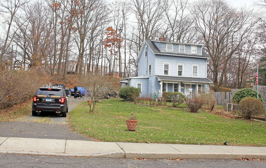 Police investigate the scene of a robbery on Ely Avenue in Norwalk Saturday afternoon. Hour Photo / Danielle Calloway