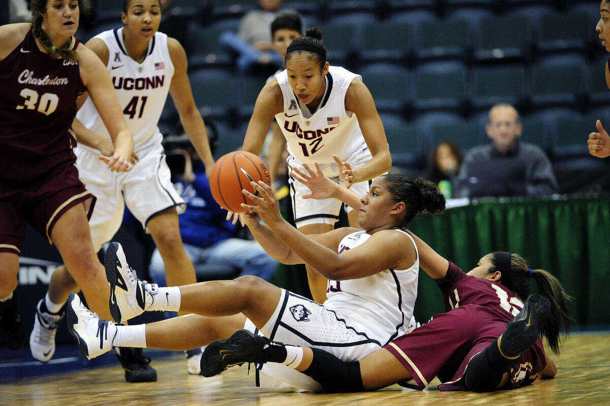Connecticut's forward Kaleena Mosqueda-Lewis (23) passes the ball from a seated position during the first half of a NCAA college women's basketball game, Friday, Nov. 28, 2014 in Estero, Fla. (AP Photo/Naples Daily News, Corey Perrine) FORT MYERS OUT