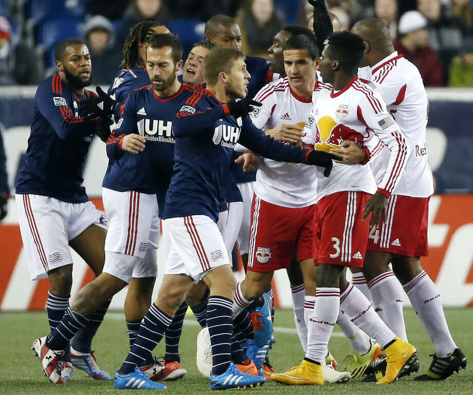 New England Revolution players, left, scuffle with New York Red Bulls players during the second half of the second soccer game of the MLS Eastern Conference final in Foxborough, Mass., Saturday, Nov. 29, 2014. The match ended 2-2 and New England advanced to the MLS Cup with a two-game aggregate 4-3. (AP Photo/Elise Amendola)