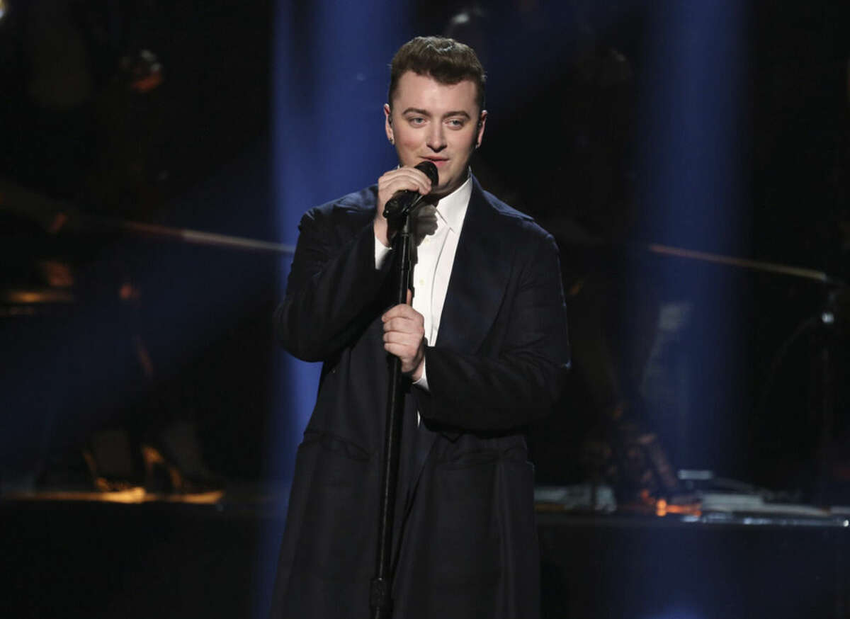 FILE - In this Nov. 23, 2014, file photo, Sam Smith performs on stage at the 42nd annual American Music Awards at Nokia Theatre L.A. Live in Los Angeles. Will the Grammys be