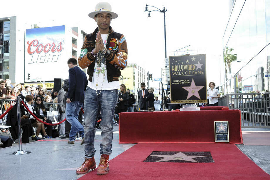 Pharrell Williams attends the ceremony honoring him with a star on the Hollywood Walk of Fame on Thursday, Dec. 04, 2014, in Los Angeles. (Photo by Richard Shotwell/Invision/AP)