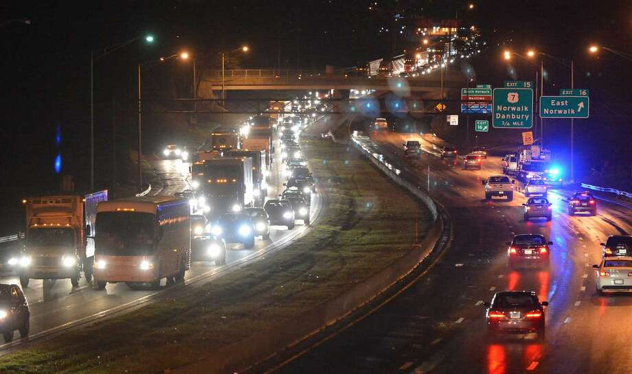 Hour Photo/Alex von Kleydorff. Traffic in both directions at a standstill on I 95 at Strawberry Hill Ave due to a water main break that flooded the southbound side