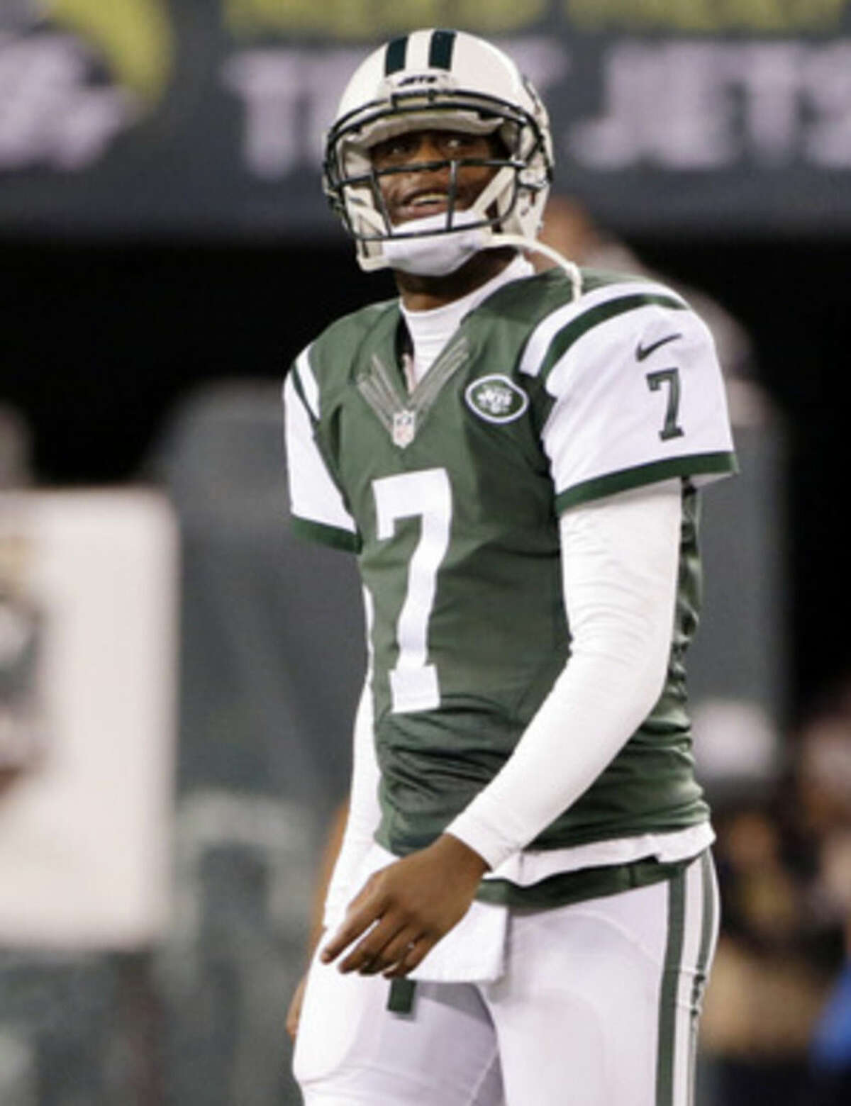 New York Jets quarterback Geno Smith (7) checks the scoreboard between plays against the Miami Dolphins during the second quarter of an NFL football game, Monday, Dec. 1, 2014, in East Rutherford, N.J. (AP Photo/Julio Cortez)