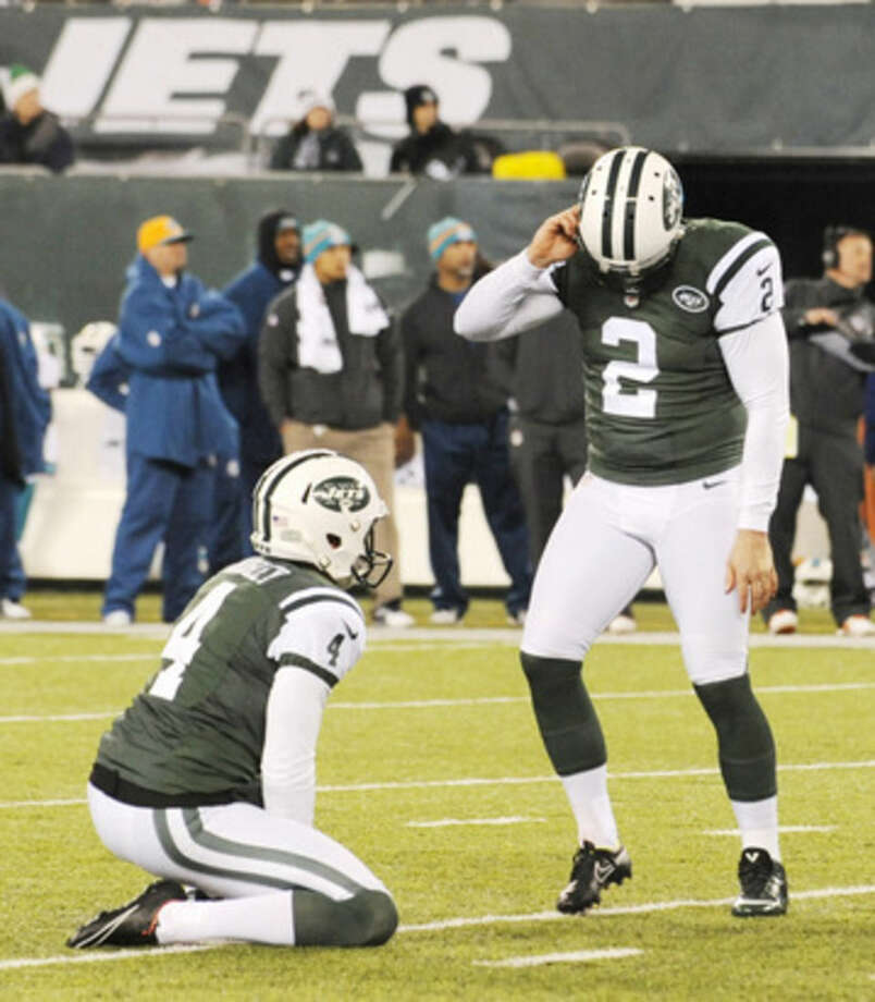 New York Jets kicker Nick Folk (2) reacts after missing a 45-yard field goal against the Miami Dolphins during the fourth quarter of an NFL football game, Monday, Dec. 1, 2014, in East Rutherford, N.J. (AP Photo/Bill Kostroun)