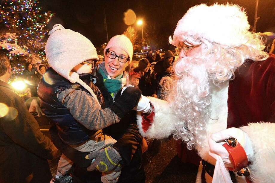 Hour Photo/Alex von Kleydorff 2 yr old Christian Capizzi and his mom Christine get candy canes from Santa Clause during the Christmas Tree lighting at Stew Leonard's on Tuesday night