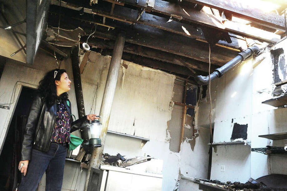 Anna Duleep, daughter of Ganga Duleep show's one of many rooms on her mother's property where fire destroyed two restaurants and upstairs areas. hour photo/matthew vinci / (C)2010 The Hour