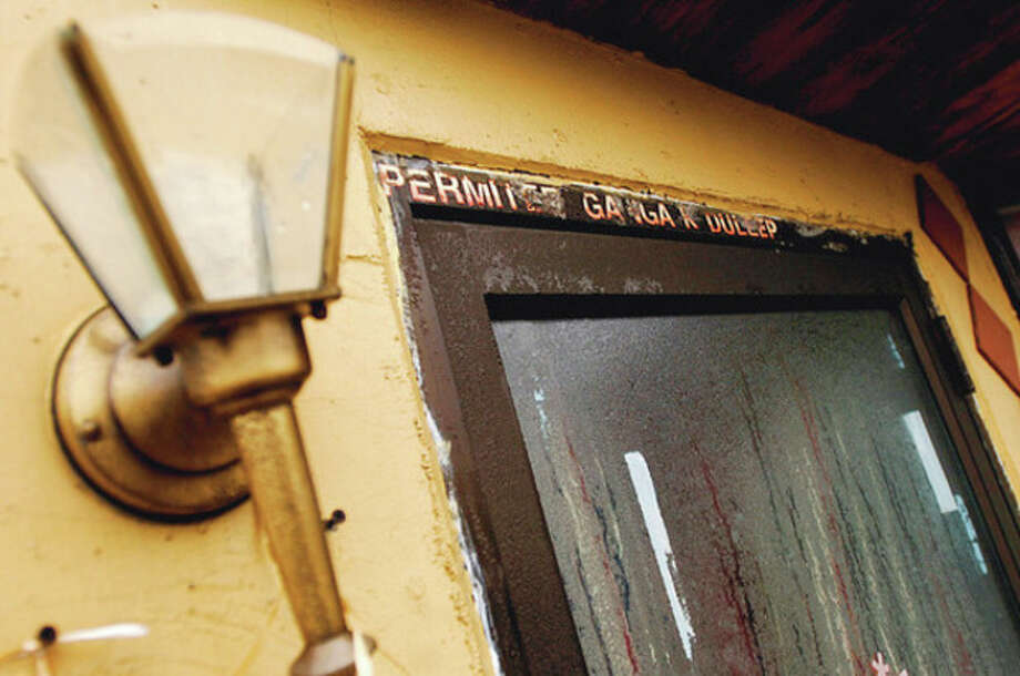 Doorway to the building at 45 Wall Street owned by Ganga Duleep. / (C)2011, The Hour Newspapers, all rights reserved