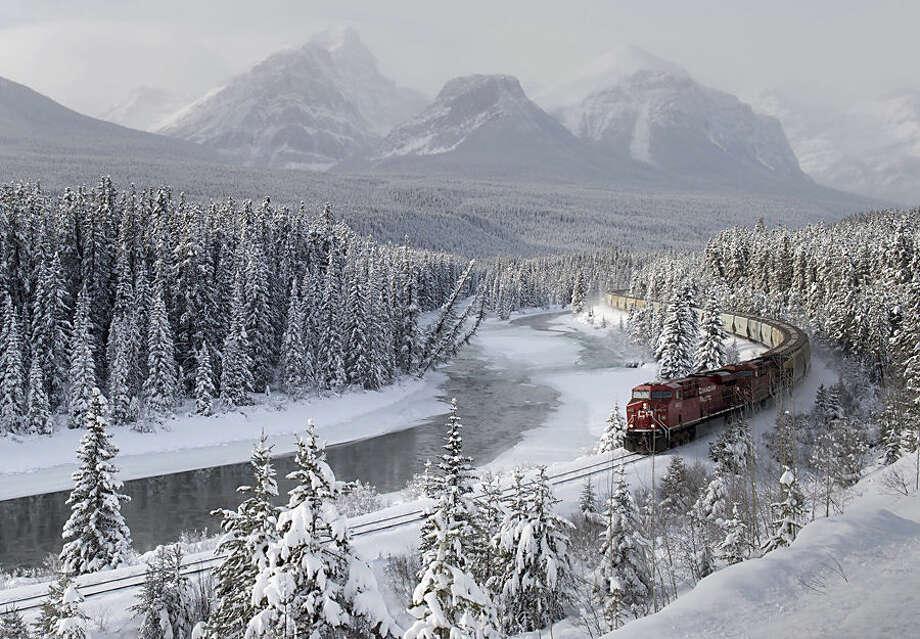 A Canadian Pacific freight train travels around Morant's Curve near Baker Creek, Alberta on Monday, Dec. 1, 2014. (AP Photo/The Canadian Press, Frank Gunn)