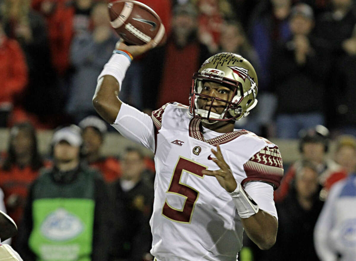 FILE - In this Oct. 30, 2014, file photo, Florida State quarterback Jameis Winston (5) looks to pass in the first half of a NCAA college football game against Louisville in Louisville, Ky. Winston begins his student code of conduct hearing Tuesday, Dec. 2, 2014, in Tallahassee, Fla.. (AP Photo/Garry Jones)