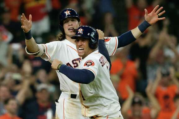 HOUSTON, TX - JUNE 04: George Springer #4 of the Houston Astros and Colby Rasmus #28 celebrate after scoiring in the twelfth inning to defeat the Oakland Athletics at Minute Maid Park on June 4, 2016 in Houston, Texas. (Photo by Bob Levey/Getty Images)