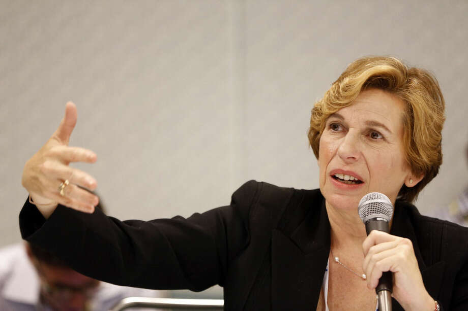 File-This July 11, 2014, file photo shows American Federation of Teachers President Randi Weingarten taking questions about U.S. Secretary of Education Arnie Duncan at an ATF convention in Los Angeles. Teachers and other school employees in Newtown are meeting with local and national union leaders to discuss issues stemming from the 2012 shooting massacre at Sandy Hook Elementary School. Weingarten is expected to meet privately with educators Tuesday in Newtown. (AP Photo/Damian Dovarganes, File)