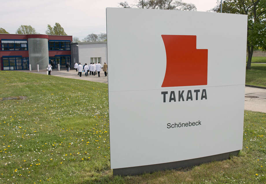 FILE - In this Thursday, April 17, 2014, file photo, journalists visit Takata Ignition Systems in Schoenebeck, Germany. Japan's Takata Corp. refused to comply with a U.S. government demand for an expanded recall of its air bags that can explode and shoot out shrapnel, and instead passed along the crucial decision to automakers. The response, which the U.S. immediately criticized as inadequate, sets the stage for a showdown between the U.S. National Highway Traffic Safety Administration and the company, when they appear before U.S. Congress on Wednesday, Dec. 3.(AP Photo/Jens Meyer, File)