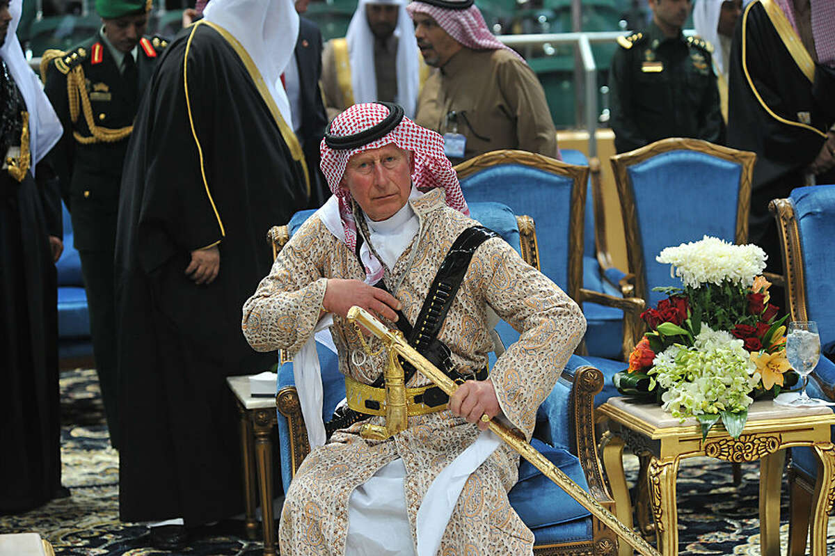 FOR USE AS DESIRED, YEAR END PHOTOS - FILE - Britain's Prince Charles wears a traditional Saudi uniform as he attends the traditional Saudi dancing best known as