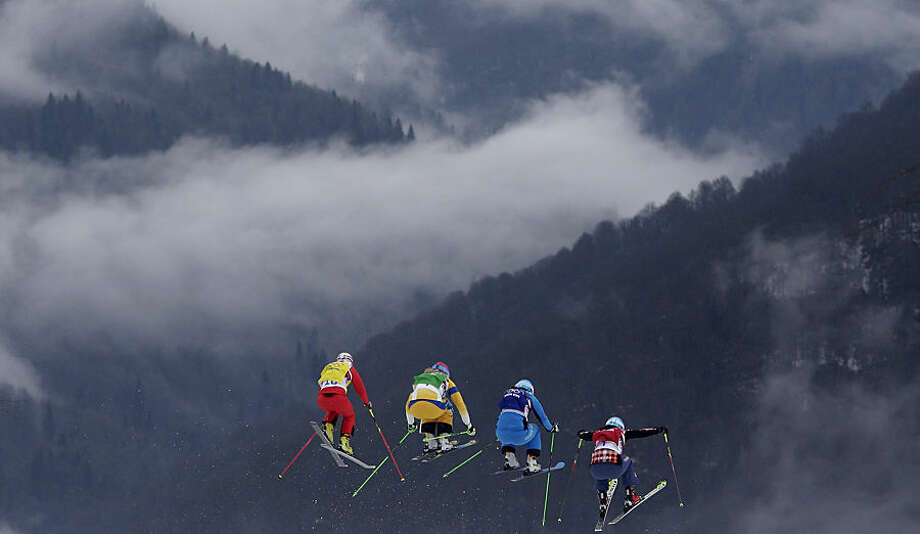 FOR USE AS DESIRED, YEAR END PHOTOS - FILE - Switzerland's Fanny Smith, from left, Sweden's Anna Holmlund, Austria's Katrin Ofner and Canada's Kelsey Serwa compete during their ski cross race at the 2014 Winter Olympics, Friday, Feb. 21, 2014, in Krasnaya Polyana, Russia. (AP Photo/Matthias Schrader, File)