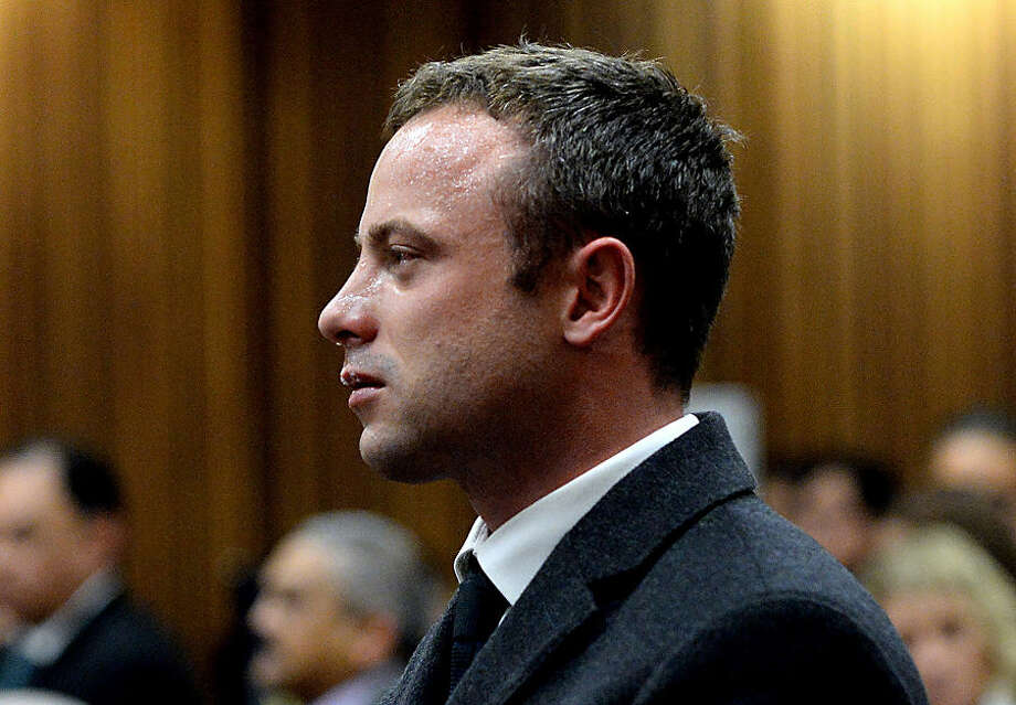 FOR USE AS DESIRED, YEAR END PHOTOS - FILE - In this photo taken Monday March 10, 2014, Oscar Pistorius cries as he listens to cross questioning about the events surrounding the shooting death of his girlfriend Reeva Steenkamp, in court during his trial in Pretoria, South Africa. Pistorius was charged with the shooting death of Steenkamp, on Valentines Day in 2013. (AP Photo/Bongiwe Mchunu, File Pool)
