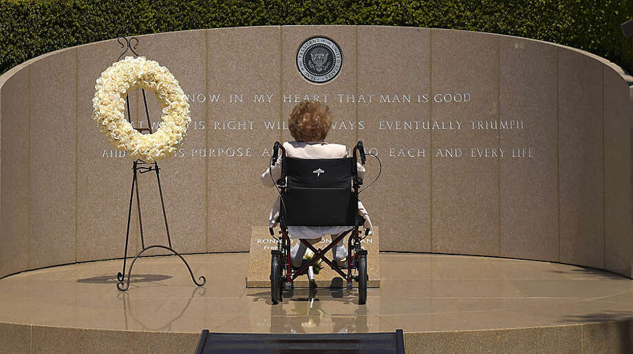 FOR USE AS DESIRED, YEAR END PHOTOS - FILE - Former first lady Nancy Reagan visits the grave site of her husband, President Ronald Reagan, at the Ronald Reagan Presidential Library, Thursday, June 5, 2014, in Simi Valley, Calif. (AP Photo/Mark J. Terrill, File)
