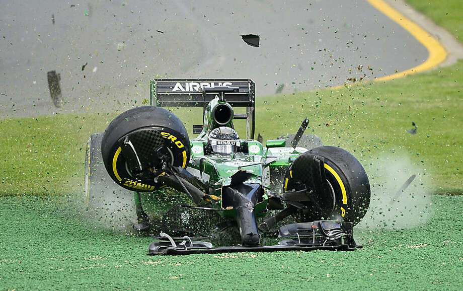 FOR USE AS DESIRED, YEAR END PHOTOS - FILE - Caterham driver Kamui Kobayashi of Japan runs off the track after he crashed with Williams driver Felipe Massa of Brazil on the first lap of the Australian Formula One Grand Prix at Albert Park in Melbourne, Australia, Sunday, March 16, 2014. Both Massa and Kobayashi walked away from the accident. (AP Photo/Ross Land, File)
