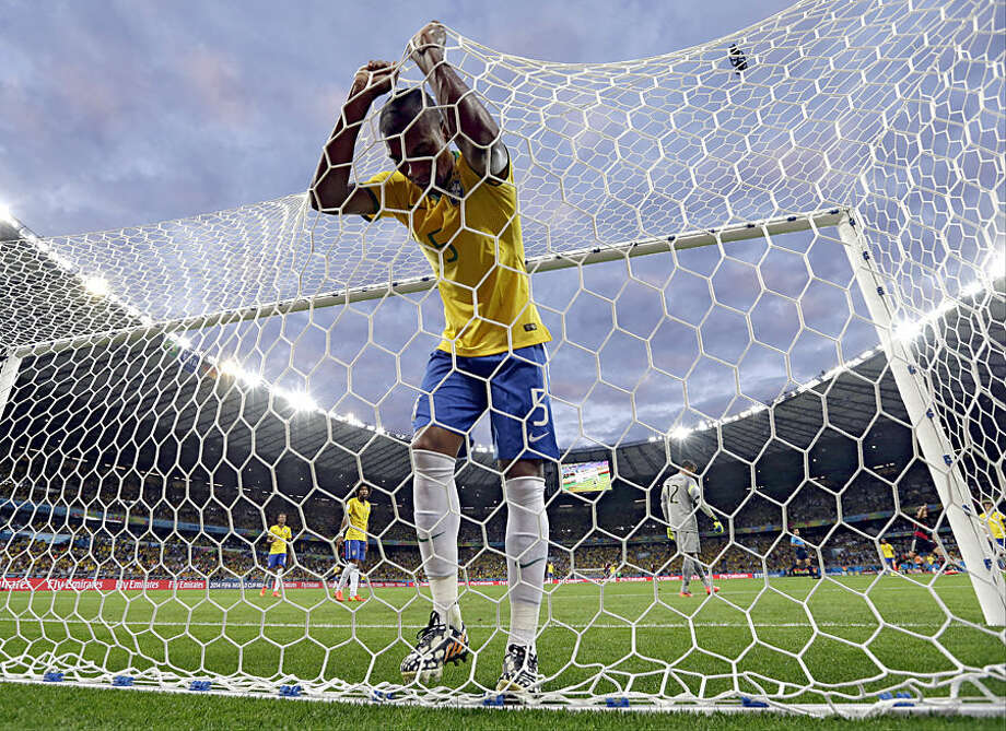 FOR USE AS DESIRED, YEAR END PHOTOS - FILE - Brazil's Fernandinho reacts after Germany's Toni Kroosduring scored his side's third goal during the World Cup semifinal soccer match between Brazil and Germany at the Mineirao Stadium in Belo Horizonte, Brazil, Tuesday, July 8, 2014. (AP Photo/Natacha Pisarenko, File)