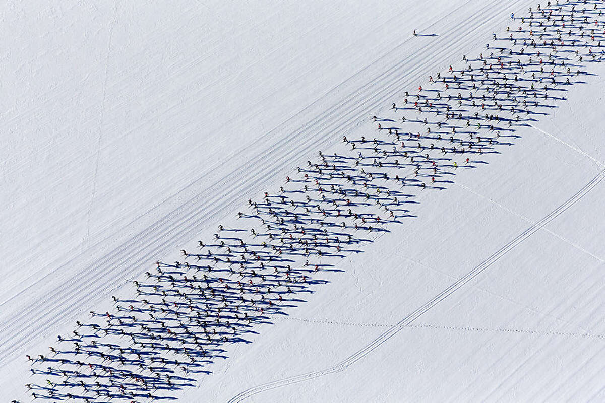 FOR USE AS DESIRED, YEAR END PHOTOS - FILE - Thousands of competitors are on their way from Maloya to S-Chanf in south Eastern Switzerland as they participate in the annual Engadin cross country skiing marathon on Sunday, March 9, 2014. (AP Photo/Keystone,Nicola Pitaro, File)