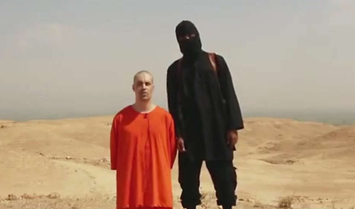 FOR USE AS DESIRED, YEAR END PHOTOS - FILE - This undated image shows a frame from a video released by Islamic State militants Tuesday, Aug. 19, 2014, that purports to show the killing of journalist James Foley by the militant group. Foley, from Rochester, N.H., went missing in 2012 in northern Syria while on assignment for Agence France-Press and the Boston-based media company GlobalPost. (AP Photo/File) ONLINE OUT