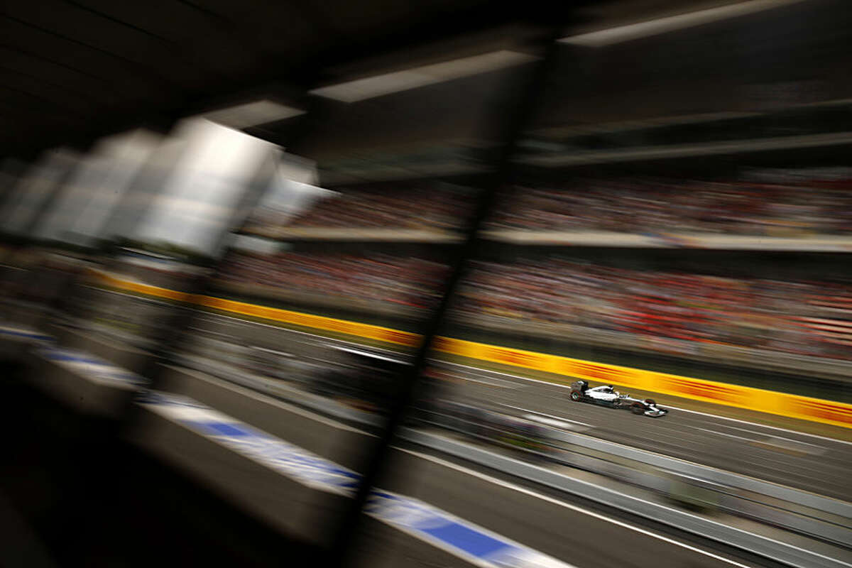 FOR USE AS DESIRED, YEAR END PHOTOS - FILE - Mercedes driver Lewis Hamilton of Britain steers his car before wining the Spain Formula One Grand Prix at the Barcelona Catalunya racetrack in Montmelo, near Barcelona, Spain, Sunday, May 11, 2014. (AP Photo/Emilio Morenatti, File)