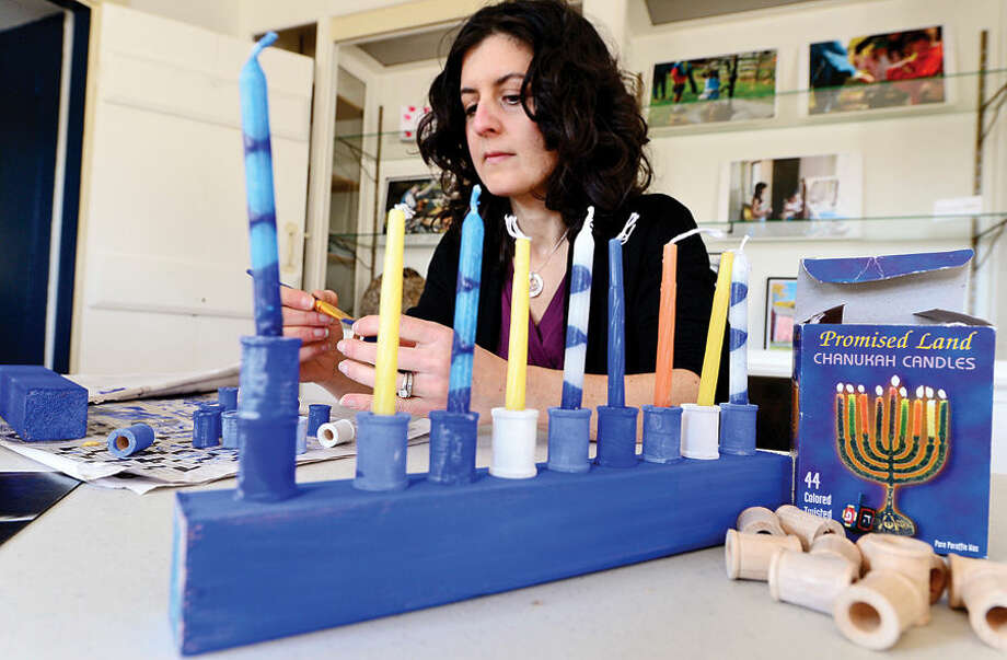 Wilton Historical Society Museum Educator Allison Reznik prepares for a menorah workshop that will be offered Sunday, Dec. 7.