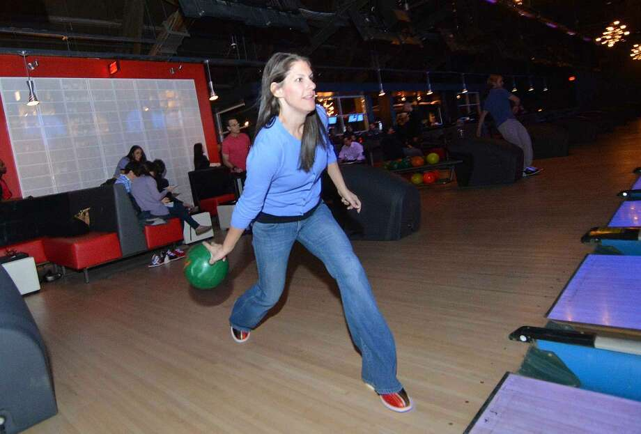 Hour Photo/Alex von Kleydorff Arielle Luksberg enjoys opening night at Bowlmor on Connecticut Ave
