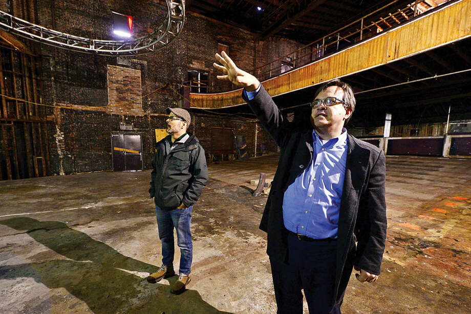 Hour photo / Erik Trautmann Developer Frank Farricker and Wall Street Theater Company Executive Director Bob Kennedy look over the stripped down former Globe Theater which will be renovated and reopen as the Wall Street Theater featuring live perfomances, interactive entertainment, cinema and digital productions.