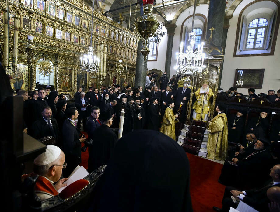 Pope Francis, bottom left, listens to Ecumenical Patriarch Bartholomew I's speech, during a holy liturgy at the Patriarchal Church of St. George in Istanbul, Sunday, Nov. 30, 2014. Pope Francis wrapped up his three-day visit to Turkey on Sunday with a liturgy alongside the spiritual leader of the world's Orthodox Christians and a meeting with young refugees who have fled Syria, Iraq and other conflict zones. (AP Photo/Gregorio Borgia)