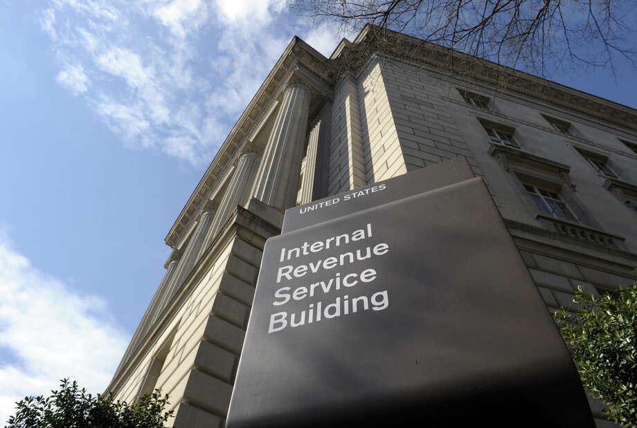 FILE - In this March 22, 2103 file photo, the exterior of the Internal Revenue Service (IRS) building is seen in Washington. House Republicans are moving to pass a one-year extension of temporary tax breaks affecting millions of businesses and individuals. Most of the more than 50 tax breaks expired at the end of 2013, so the extension would only run through the end of the month. However, it would allow taxpayers to claim the tax breaks when they file their 2014 tax returns. (AP Photo/Susan Walsh, File)