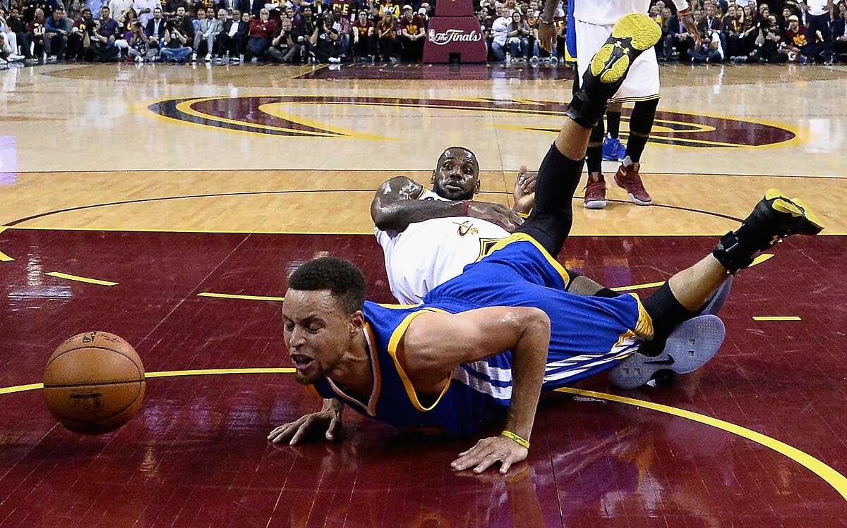 LeBron James of the Cleveland Cavaliers reacts as Stephen Curry #30 of the Golden State Warriors falls during the first half in Game 4 of the 2016 NBA Finals at Quicken Loans Arena on June 10, 2016 in Cleveland, Ohio.