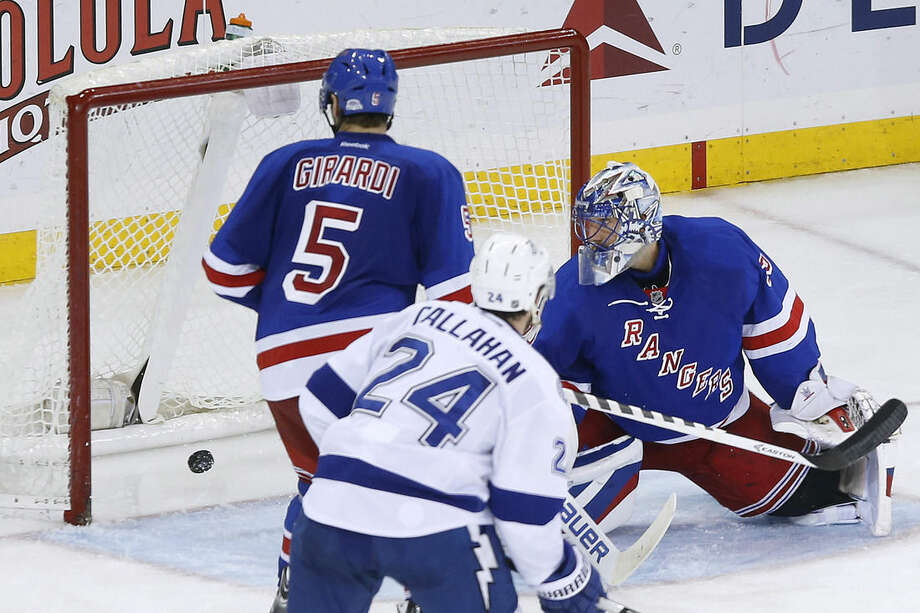 New York Rangers goalie Henrik Lundqvist, right, of Sweden, watches as a shot from Tampa Bay Lightning's Brett Connolly, not pictured, gets past him during the third period of an NHL hockey game Monday, Dec. 1, 2014, in New York. Tampa Bay won 6-3. (AP Photo/Jason DeCrow)